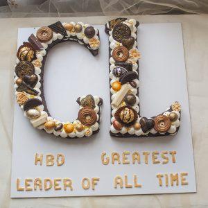 کیک تولد حروف GL شکلاتی طلایی