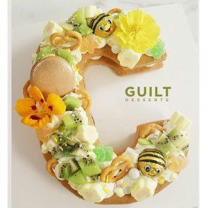 guiltdesserts 44 300x300 - بیسکوکیک  حرف c تم سبز و زرد