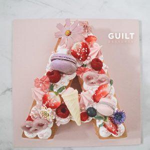 guiltdesserts 61 300x300 - بیسکوکیک  حرف A تم ماکارون و گل