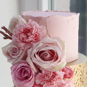 سفارش کیک تولد دو طبقه صورتی طلایی